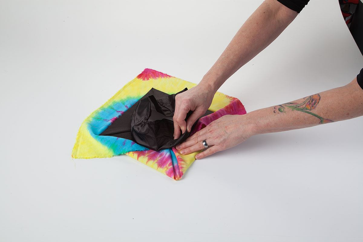 How to Tie Dye Graduation Cap press on dyed fabric to cap