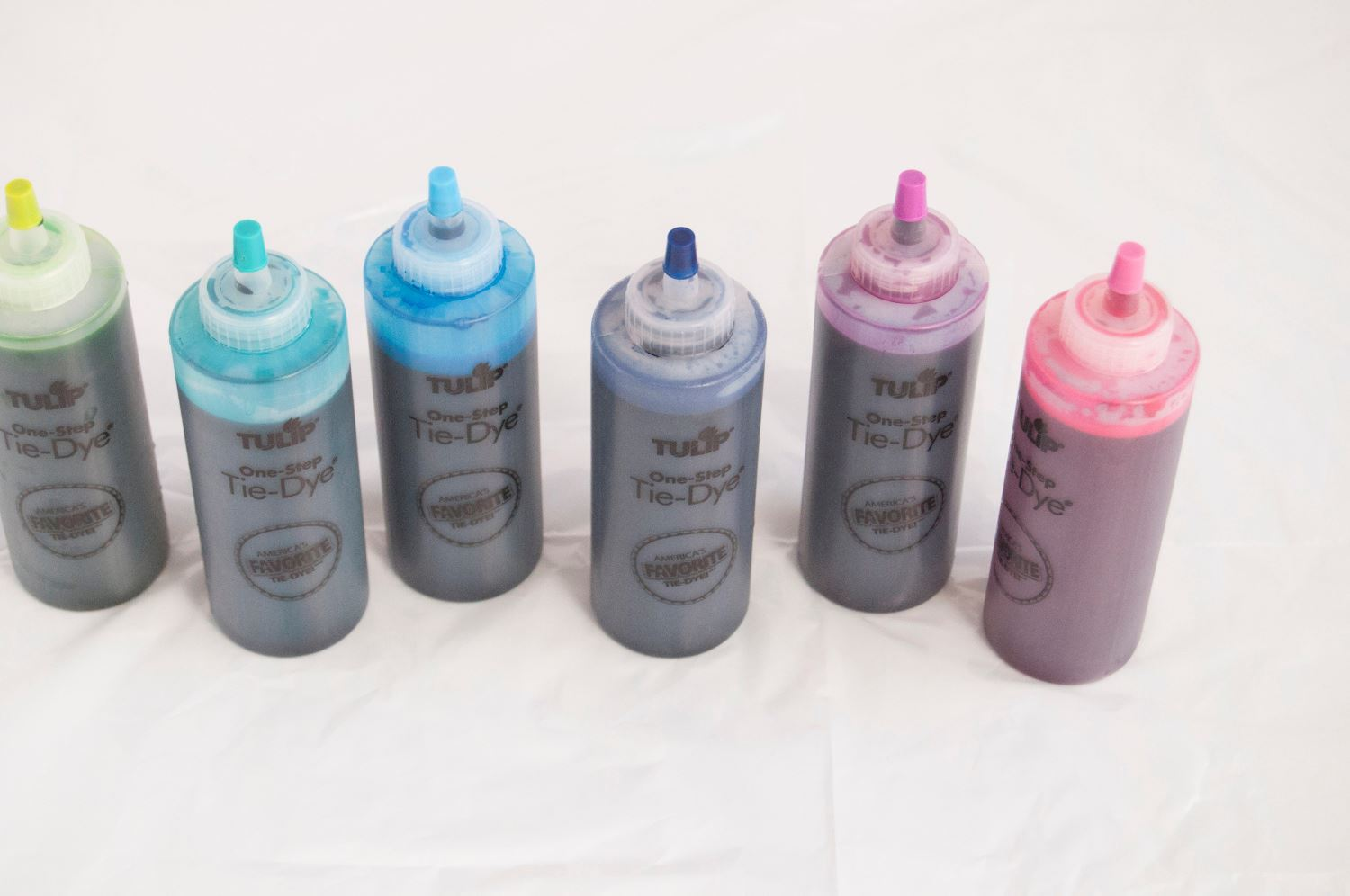 Add water to dye bottles and shake to mix