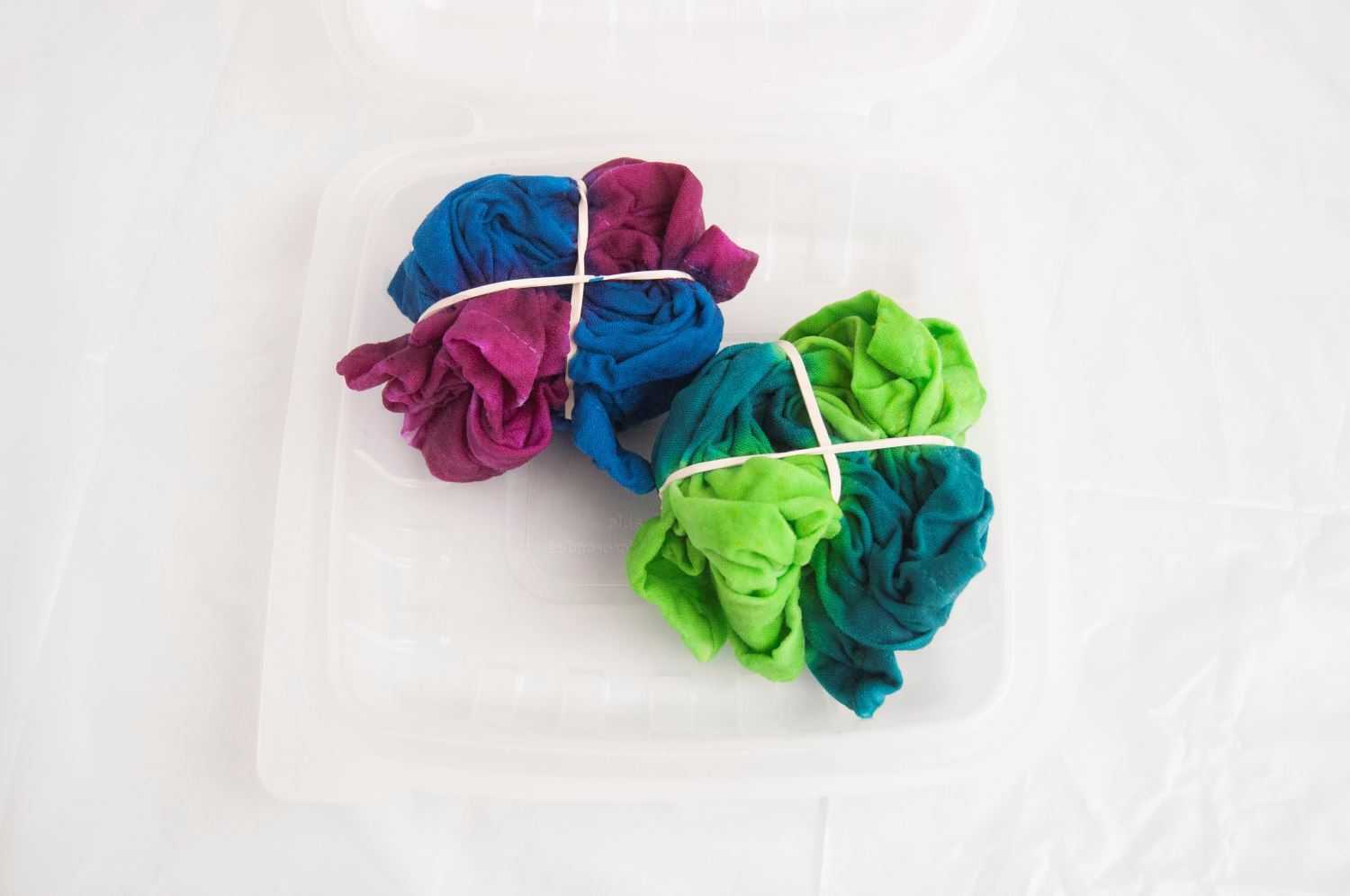 Place dyed fabric into Two-Minute Tie Dye Container
