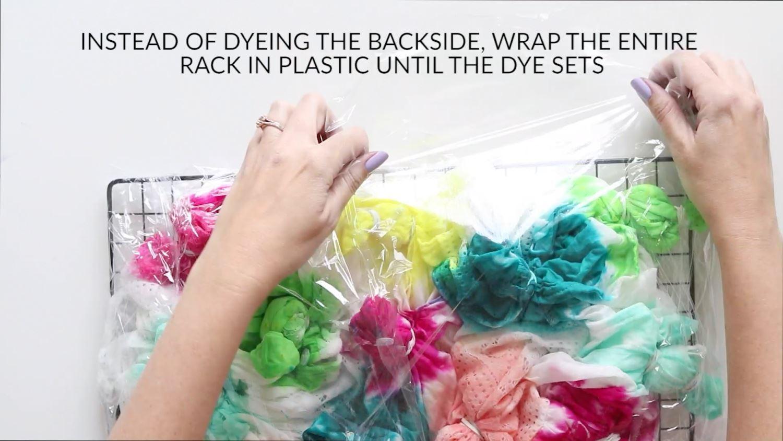 Wrap dyed kimono in plastic while dye sets