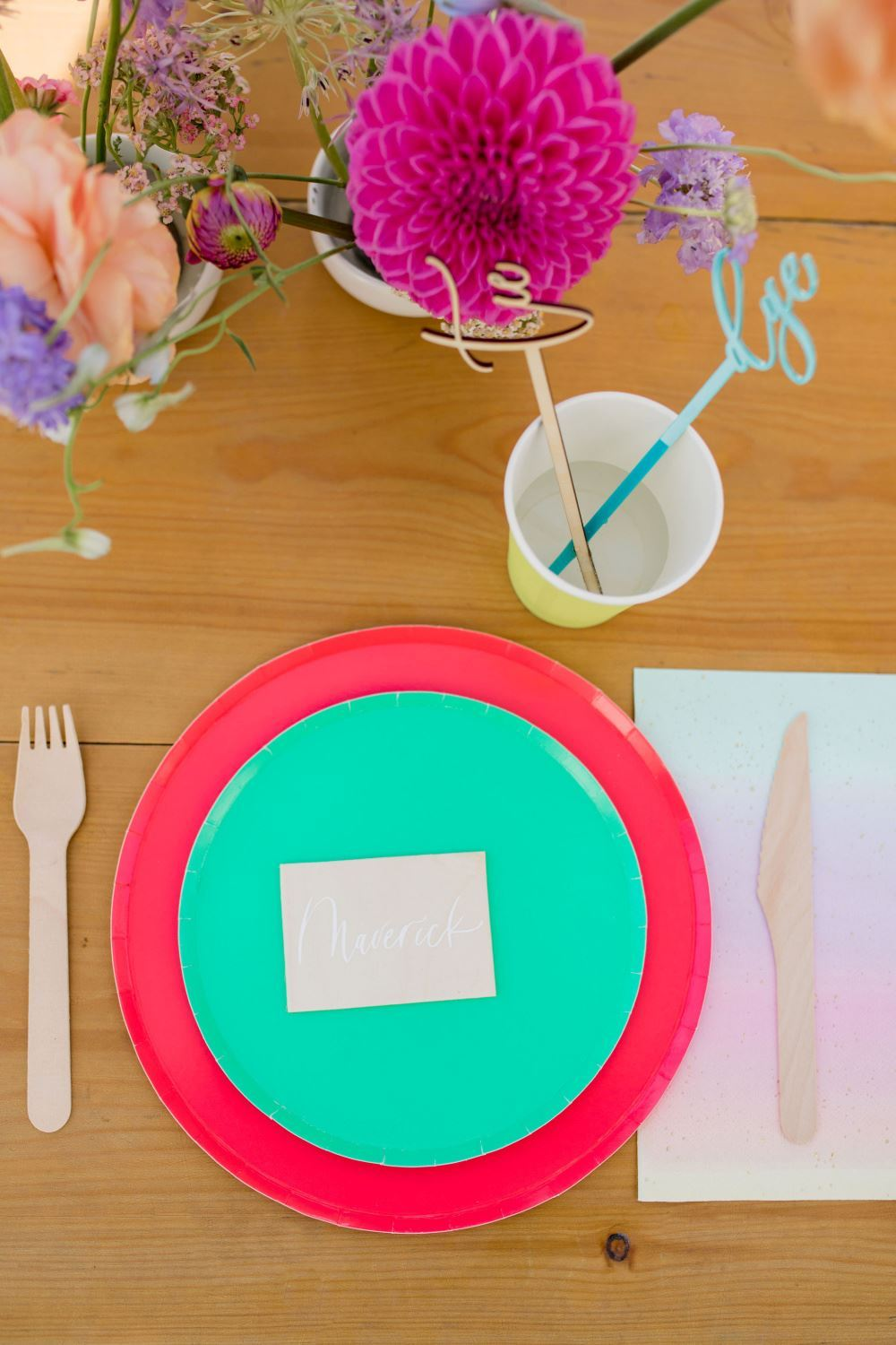 Colorful place settings for a backyard tie-dye party