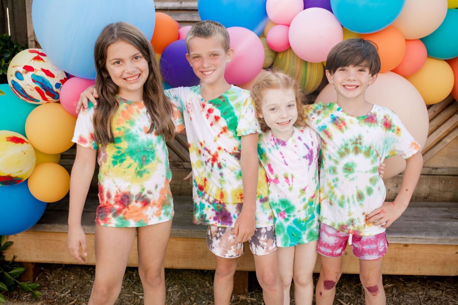 Use balloons as a colorful tie-dye party photo backdrop