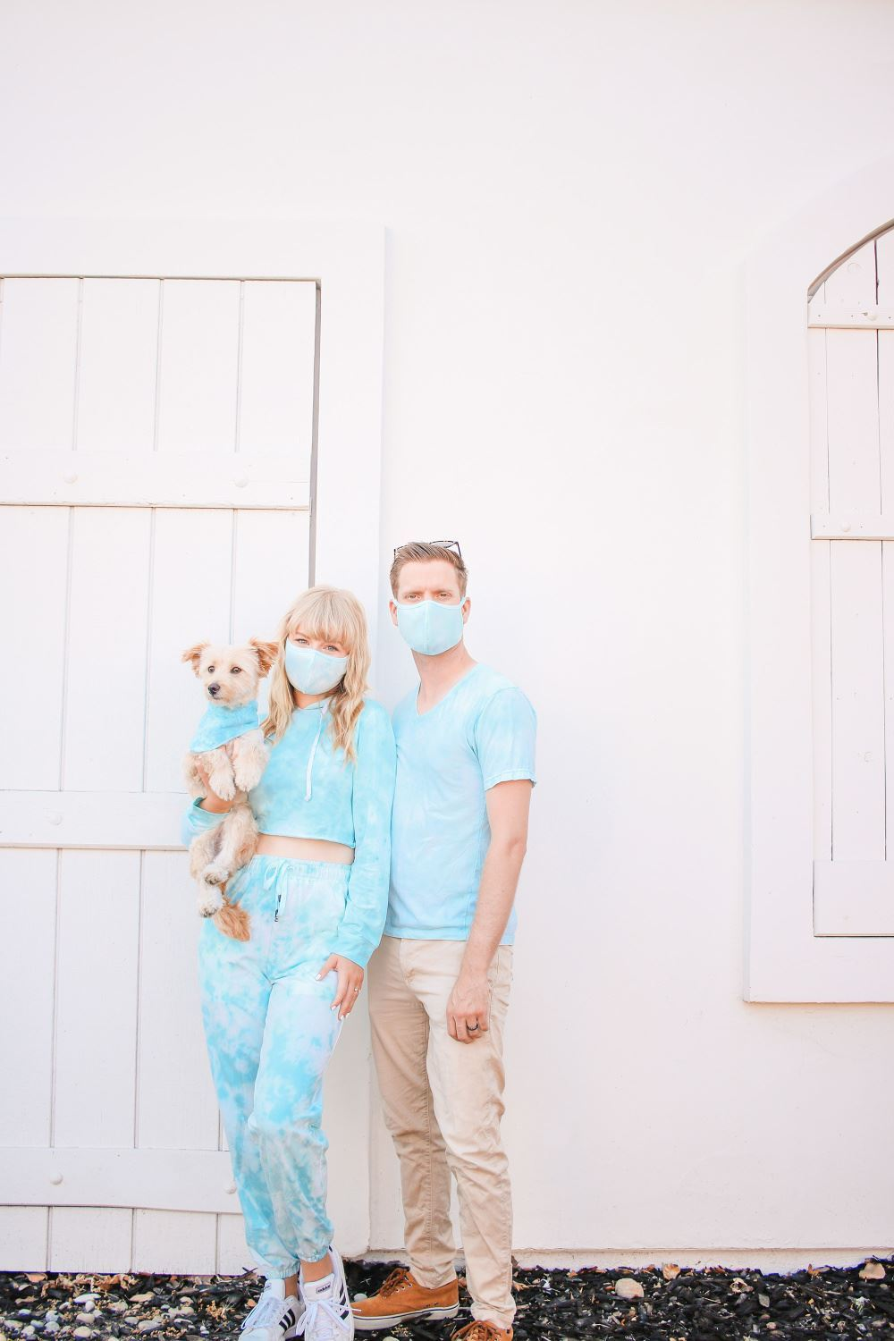 Matching tie-dye outfits and masks
