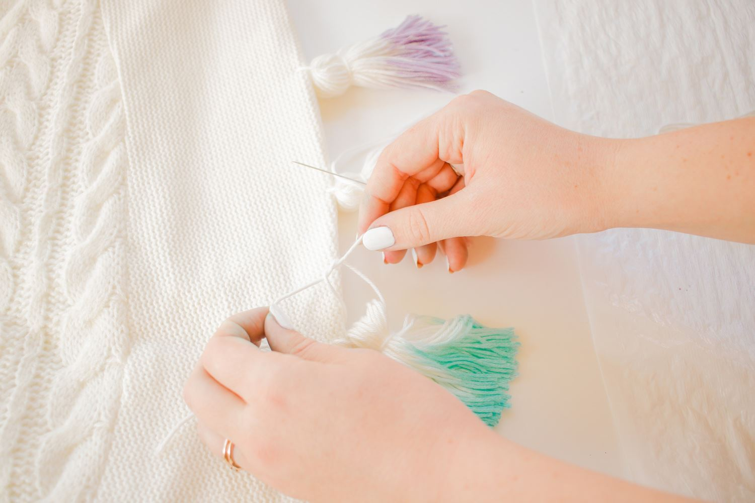 Sew and tie tassels to tree skirt