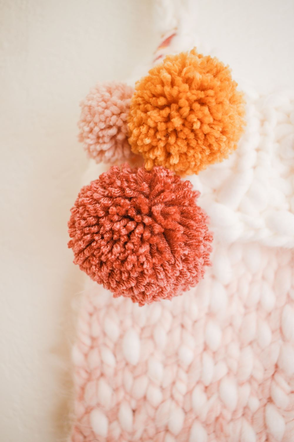 Attach pompoms to stockings